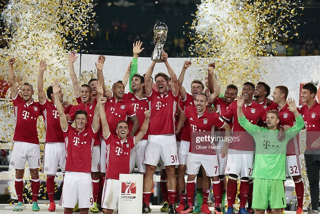 Team of Munich celebrates with the Trophy after the DFL Supercup 2016 match between Borussia Dortmund and FC Bayern Muenchen at Signal Iduna Park on August 14, 2016 in Dortmund, Germany.