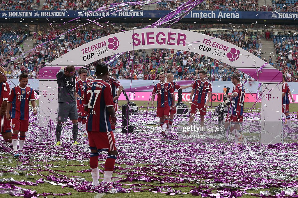 Team of Munich celebrates with the trophy after the Telekom Cup 2014 Finale match between FC Bayern Muenchen and Borussia Moenchengladbach at Imtech Arena on July 27, 2014 in Hamburg, Germany.