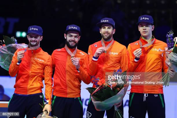 Team of Netherlands with Sjinkie Knegt Dennis Visser Itzhak de Laat and Daan Breeuwsma with the gold medal celebrate after the Men's 5000 meters...