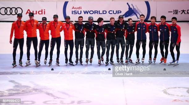 Team of Netherlands with the silver medal Team of Canada with the gold medal and Team of China with the bronze medal celebrate after the Mens 5000m...