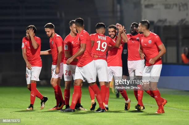 Team of Nimes celebrates the first goal during the Ligue 2 match between Nimes Olympique and Brest on October 20 2017 in Nimes France
