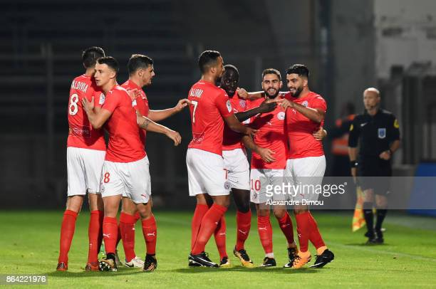 Team of Nimes celebrates the First Goal during the Ligue 2 match between Nimes Olympique and Stade Brestois at on October 20 2017 in Nimes France