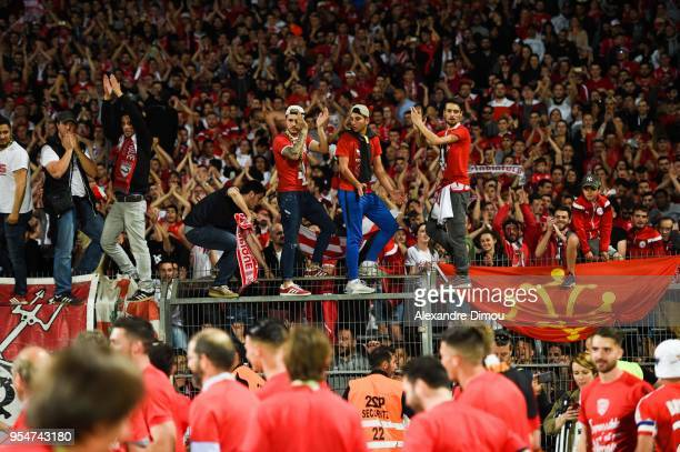 Team of Nimes celebrates the rise in Ligue1 during the French Ligue 2 match between Nimes and Gazelec Ajaccio at Stade des Costieres on May 4 2018 in...