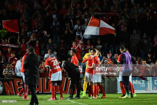 Team of Nimes celebrates the victory with fans during the Ligue 2 match between Nimes Olympique and Us Orleans on April 14 2017 in Nimes France
