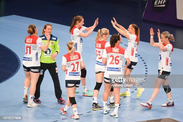 Team of Norway celebrates the victory during the EHF Euro match between Sweden and Norway on December 14 2018 in Paris France