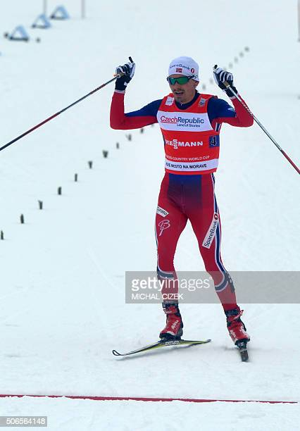 Team of Norway's Finn Haagen Krogh reacts as he crosses finish line during the men 4x75 km Relay Classic Free event of the FIS CrossCountry World Cup...