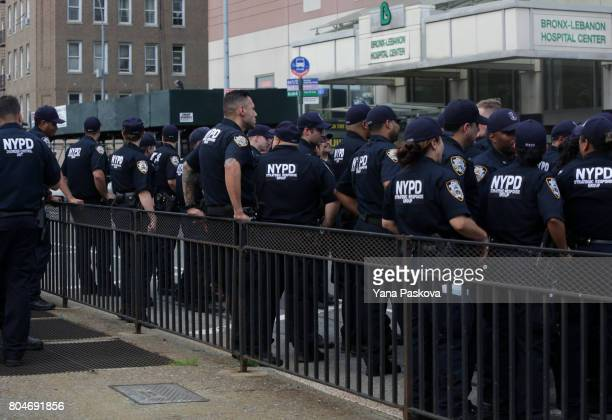 A team of NYPD and FDNY officers gather outside of BronxLebanon Hospital Center on June 30 2017 in the Bronx borough of New York city A former...