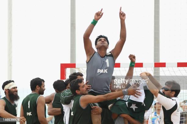Team of Pakistan celebrate winning during the Beach Handball Men's Team Finals Bronze Medal match between Oman and Pakistan on Day 6 of the 3rd Asian...