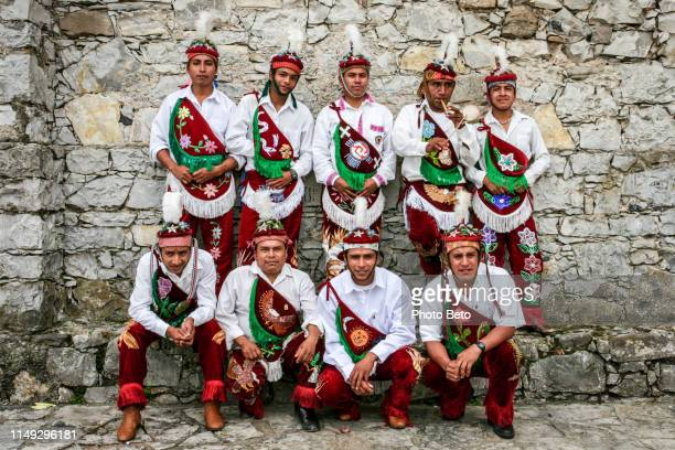 a team of voladores of papantla in traditional costumes in cuetzalan in eastern mexico - puebla state stock pictures, royalty-free photos & images