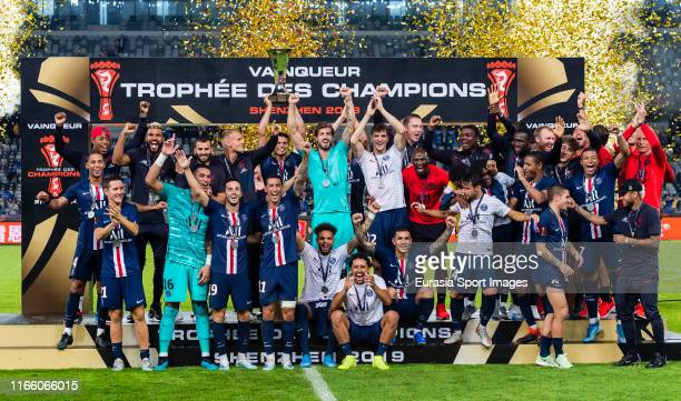 Team of Paris saint-Germain celebrates the victory with the trophy after winning the 2019 Trophee des Champions against Stade Rennais FC at Shenzhen...