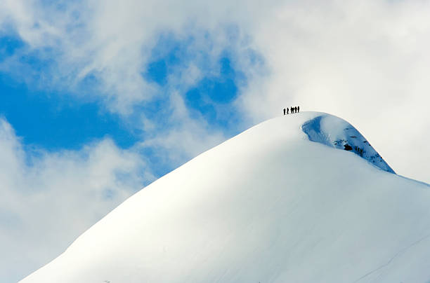 A Team Of People Climbing A Snowy Mountain Wall Art