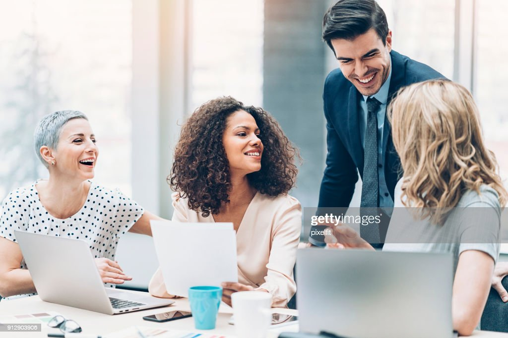 Team of professionals in discussion : Stock Photo