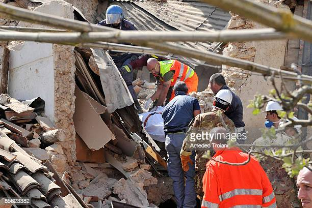 Team of rescuers carry a victim of the earthquake from the rubble on April 6, 2009 in Onna, Italy. The 6.3 magnitude earthquake tore through central...
