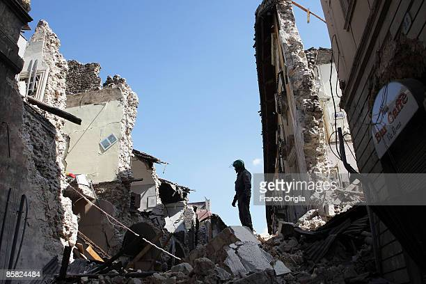 Team of rescuers search for survivors in the rubble of buildings destroyed by an earthquake on April 6, 2009 in L'Aquila, Italy. The 6.3 magnitude...