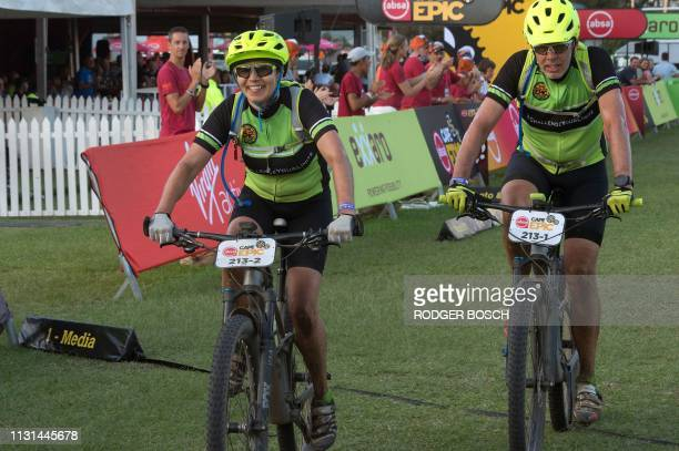 A team of riders cross the finish line after just making the 10 hour cutoff time to complete the first full stage of the 2019 Cape Epic mountain bike...