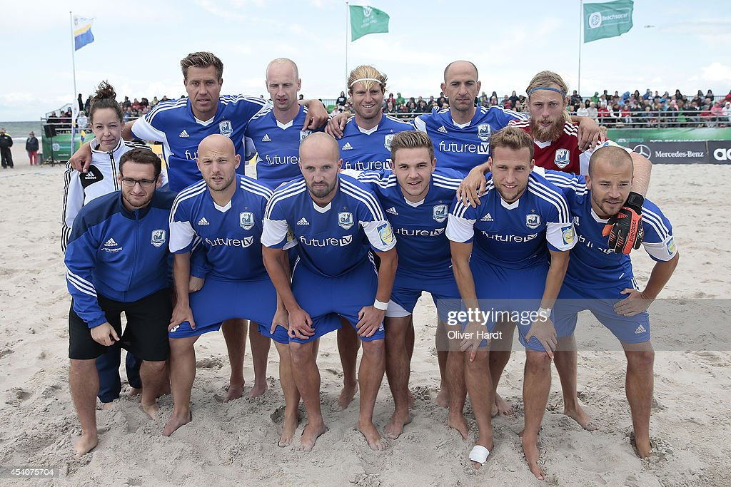 A Team of Rostock poses before the final match between BST Chemnitz and Rostocker Robben on day two of the DFB Beachscoccer Cup at the beach of Warnemunde on August 24, 2014 in Warnemunde, Germany.