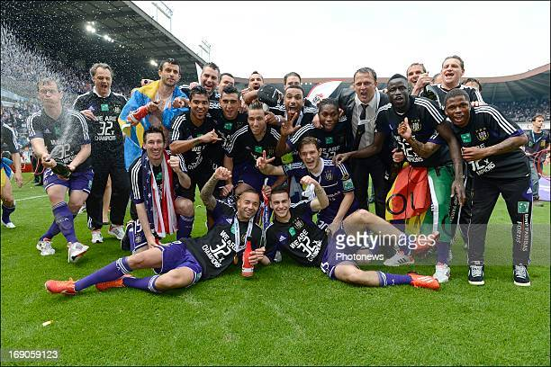 team of RSCA celebrates winning the Jupiler League title 2012 2013 for the 32nd time in the history of the club on May 19 2013 in Anderlecht Belgium