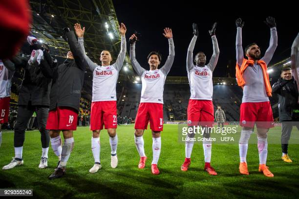 Team of Salzburg celebrates after winning the UEFA Europa League Round of 16 match between Borussia Dortmund and FC Red Bull Salzburg at the Signal...