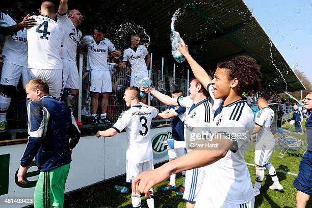 Team of Schalke celebrates after the DFB Junioren Pokal Semifinal match between Hannover 96 and FC Schalke 04 on March 30 2014 in Hanover Germany