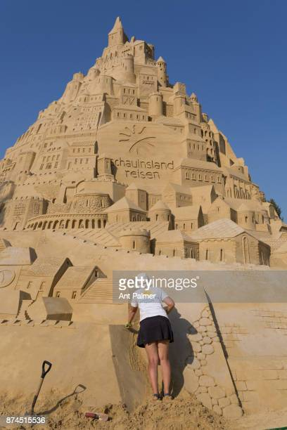 A team of sculptors work on a giant sandcastle in an attempt to break a Guiness World Record on August 29 2017 in Duisberg Germany