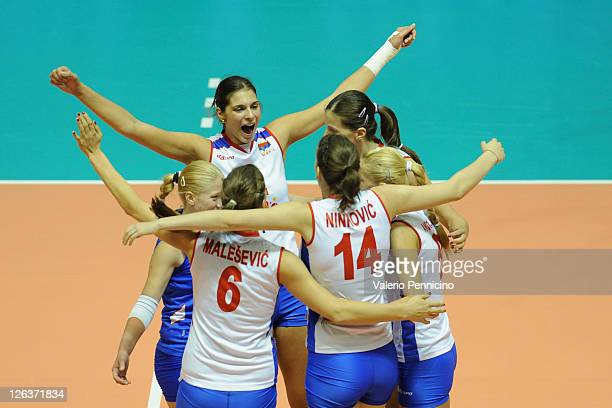 Team of Serbia celebrate a point against Ukraine during the women Volleyball European Championship match between Serbia and Ukraine on September 25...