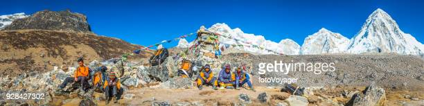 Team of Sherpa mountaineers resting below Everest Himalayas panorama Nepal