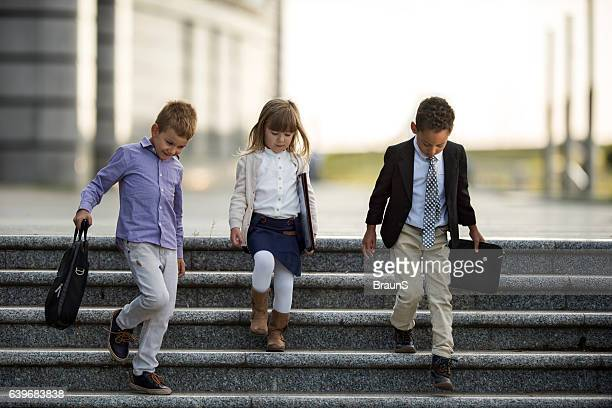 Team of small business people moving down the stairs.