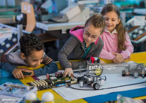 team of small engineers working together in laboratory. - stem stock photos and pictures