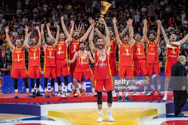 Team of Spain celebrate their victory at the cup ceremony after winning the FIBA World Cup 2019 match against the Argentina National Team at Beijing...