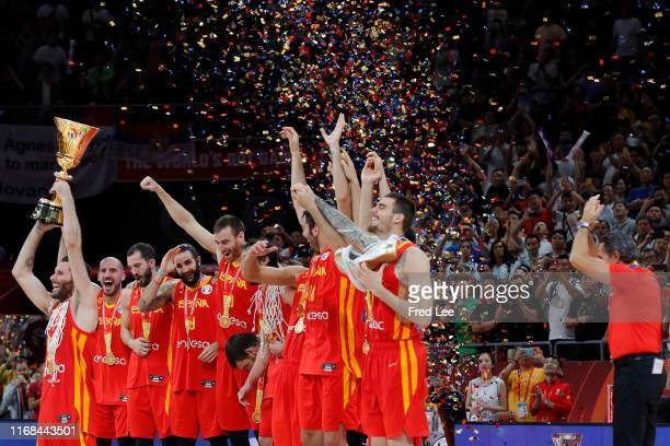 Team of Spain celebrate their victory during the cup ceremony after the FIBA World Cup 2019 against the Argentina National Team during the final of...