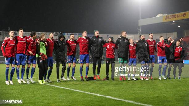 Team of SpVgg Unterhaching celebrate after the 3 Liga match between SpVgg Unterhaching and 1 FC Kaiserslautern at Alpenbauer Sportpark on November 30...