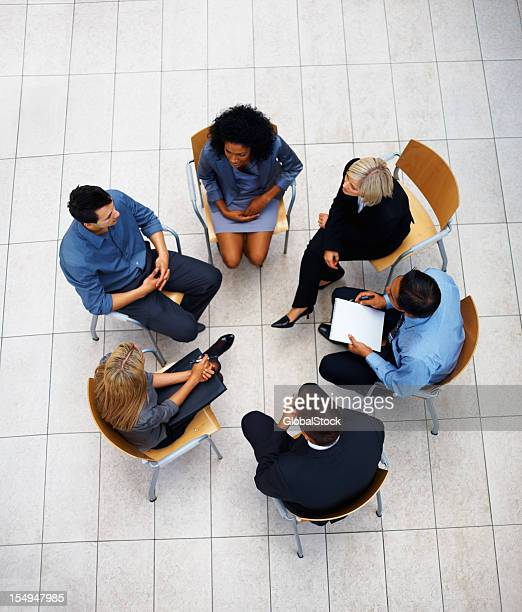 Team of successful business people sitting and discussing