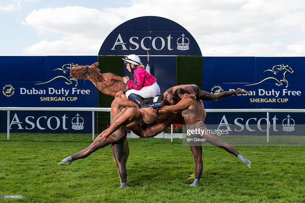 A team of ten acrobats form the shape of a racehorse crossing the winning post ridden by Stefanie Hofer to celebrate the upcoming Dubai Duty Free Shergar Cup at Ascot Racecourse on July 29, 2014 in Ascot, England. The Dubai Duty Free Shergar Cup is the only team-format raceday in the UK and takes place on 9th August.