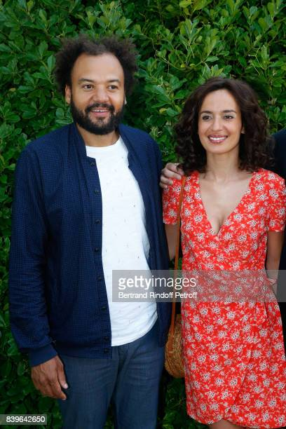 Team of the movie 'Coexister' director Fabrice Eboue and actress Amelle Chahbi attend the 10th Angouleme FrenchSpeaking Film Festival Day Five on...