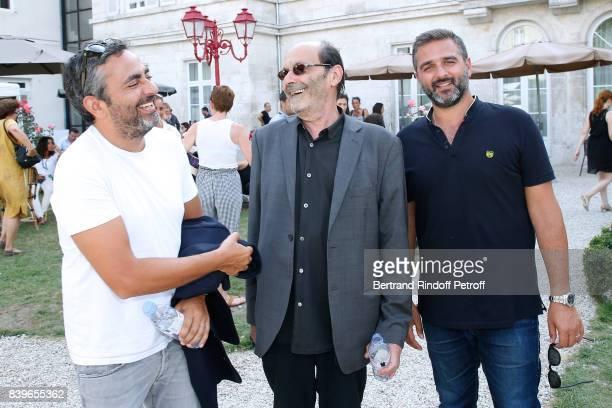 Team of the movie 'Le sens de la fete' Codirector Eric Toledano actor JeanPierre Bacri and codirector Olivier Nakache attend the 10th Angouleme...
