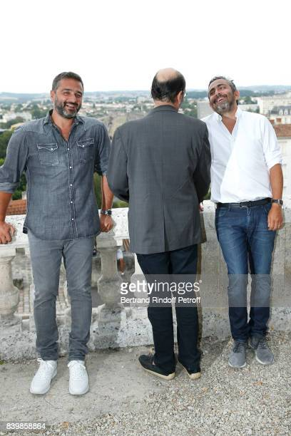 Team of the movie 'Le sens de la fete' codirector Olivier Nakache actor JeanPierre Bacri and codirector Eric Toledano attend the 10th Angouleme...