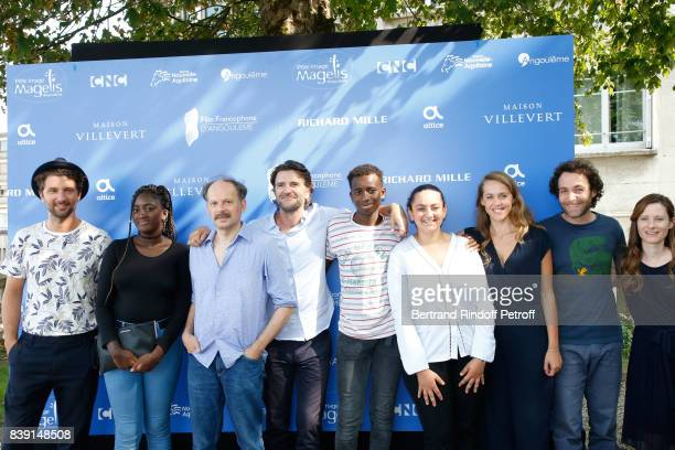 Team of the movie 'Les grands esprits' actor Denis Podalydes director Olivier AyacheVidal actors Salon Fanta Abdoulaye Diallo and Mona Magdy Fahim...