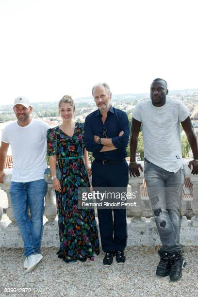 Team of the movie 'Surface de reparation' actors Franck Gastambide Alice Isaaz Hippolyte Girardot and Moussa Mansaly attend the 10th Angouleme...