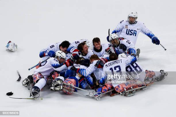 Team of the United States celebrates the gold medal after winning in the Ice Hockey gold medal game between United States and Canada during day nine...