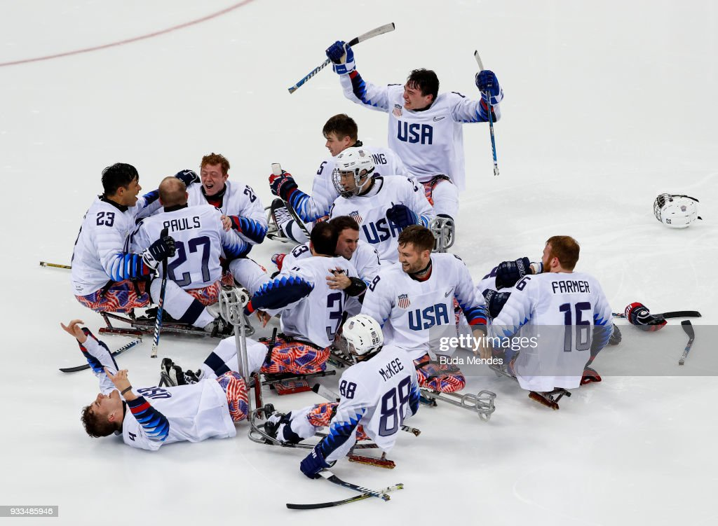 Team of the United States celebrates the gold medal after winning in the Ice Hockey gold medal game between United States and Canada during day nine of the PyeongChang 2018 Paralympic Games on March 18, 2018 in Gangneung, South Korea.