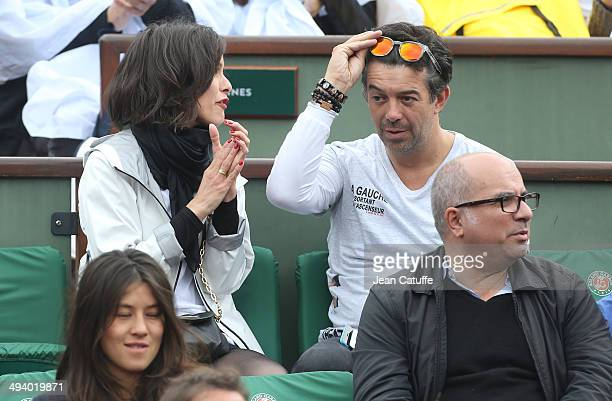 Team of theater play 'A gauche en sortant de l'ascenseur' Caroline Burgues and Stephane Plaza attend the Roland Garros French Tennis Open 2014 Day 2...