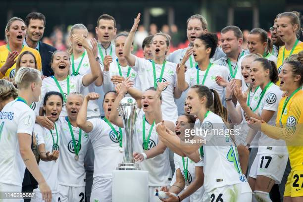 Team of VfL Wolfsburg celebrate with a trophy after winning the Women's DFB Cup final match between VfL Wolfsburg and SC Freiburg at...