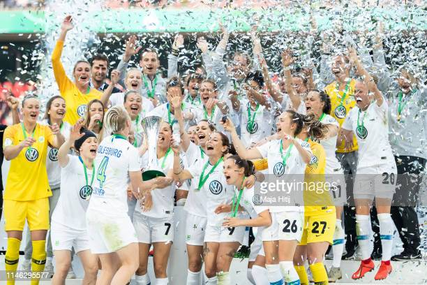 Team of VfL Wolfsburg celebrates with a trophy after winning the Women's DFB Cup final match between VfL Wolfsburg and SC Freiburg at...