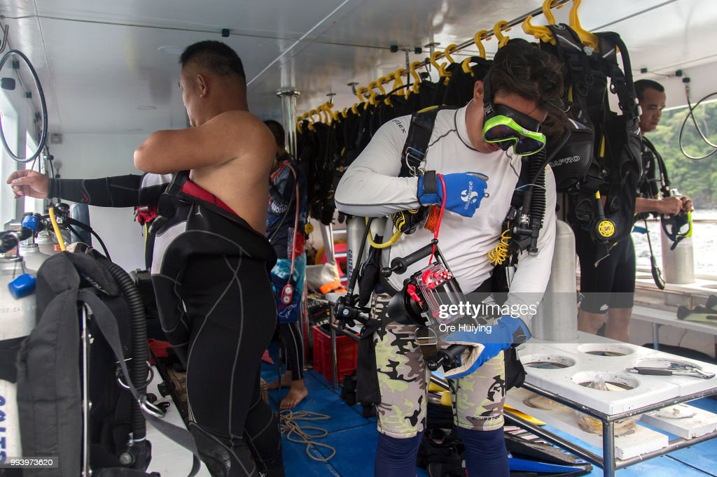 A team of volunteers made up of Chinese rescue experts and divers from a Thai diving center prepare to enter the sea for a search on the fourth day of rescue operation of capsized tourist boat Phoenix on July 8, 2018 in Phuket, Thailand. At least 42 people drowned and another 14 missing two days after a tourist boat carrying mostly Chinese passengers capsized off the holiday island of Phuket in southern Thailand. The boat carried 105 people, including 93 tourists, 11 crew and one tour guide, and went down during severe weather on Thursday evening as authorities announced all of the dead are Chinese nationals.