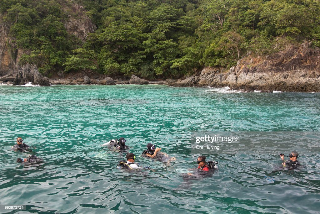 A team of volunteers made up of Chinese rescue experts and divers from a Thai diving center prepare to search underwater on the fourth day of rescue operation of capsized tourist boat Phoenix on July 8, 2018 in Phuket, Thailand. At least 42 people drowned and another 14 missing two days after a tourist boat carrying mostly Chinese passengers capsized off the holiday island of Phuket in southern Thailand. The boat carried 105 people, including 93 tourists, 11 crew and one tour guide, and went down during severe weather on Thursday evening as authorities announced all of the dead are Chinese nationals.