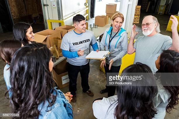 Team of volunteers meeting before community food drive