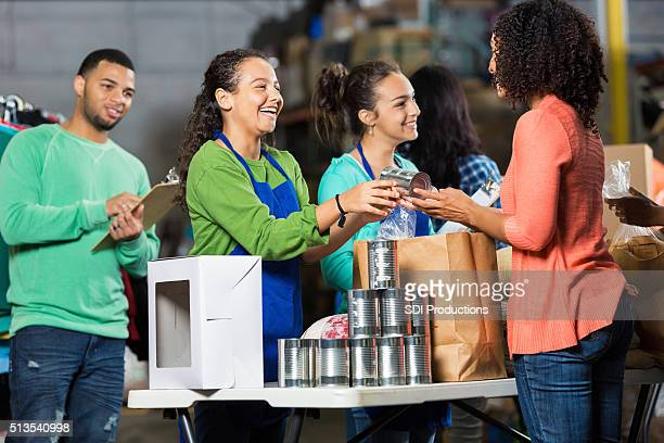 team of volunteers receive donated items - charity benefit stock pictures, royalty-free photos & images