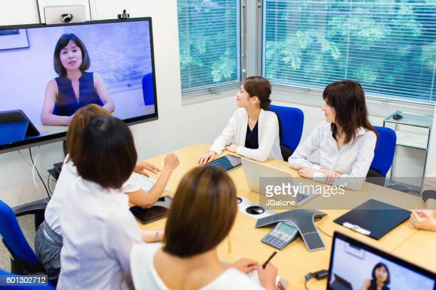 Team of women in a video conference meeting