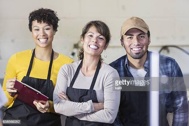 Team of workers in food market