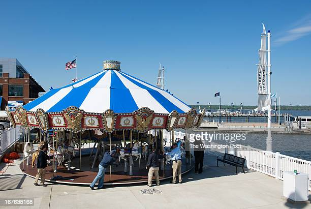 A team of workers installs the carousel National Harbor is adding a 36foot Americanathemed carousel on the waterfront It features 30 animals...